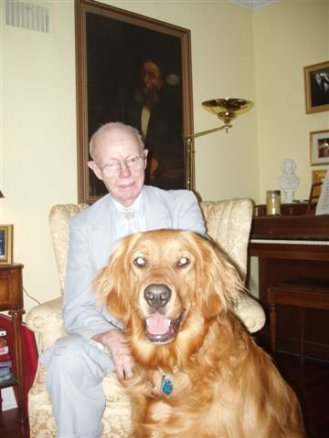 My father, H. E. Riordan,  and his favorite dog.